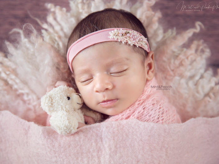 Newborn girl sleeping shoot